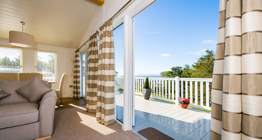 Image showing the living and outdoor decking areas of Wemyss Bay accessible holiday home